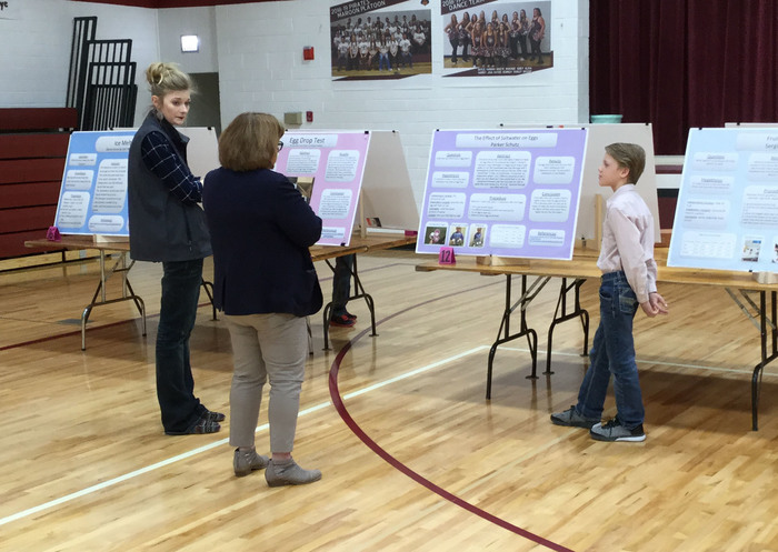 Elwood Science Fair Poster and a student presenting