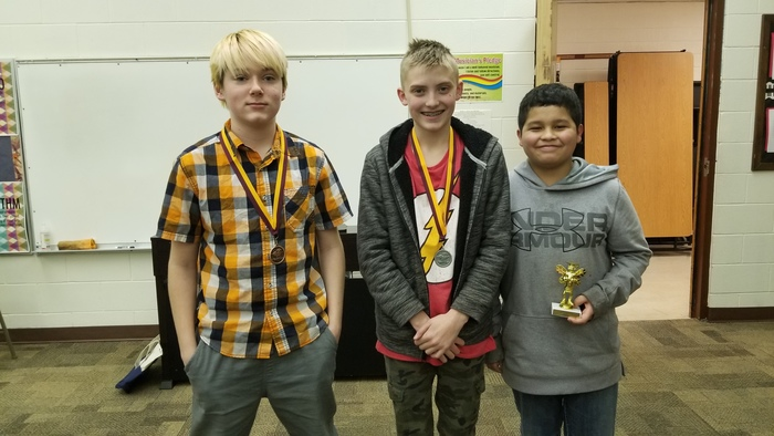 The top three spellers from the 2019 Gosper County Spelling Bee (right to left:  Champion Steven Duran, 2nd place Gavin Tilson, and 3rd place Heath McHugh).
