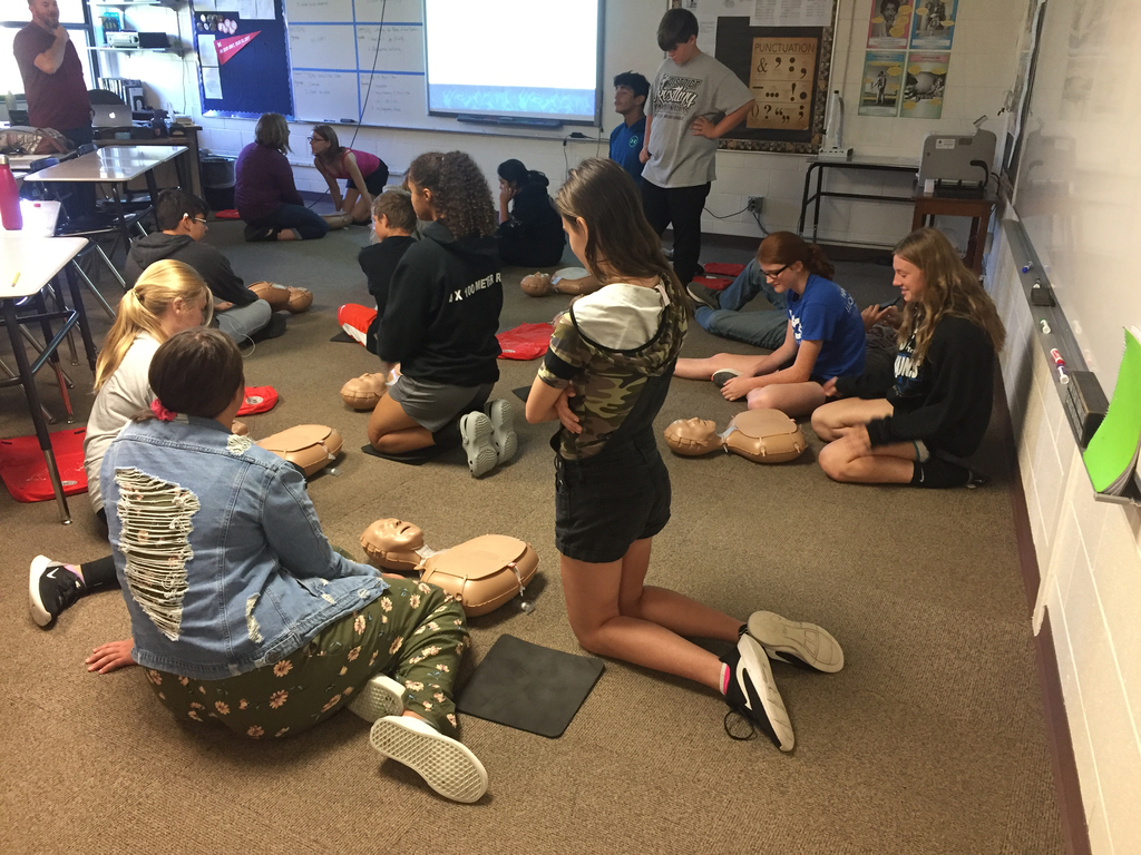 9th graders getting trained on CPR.