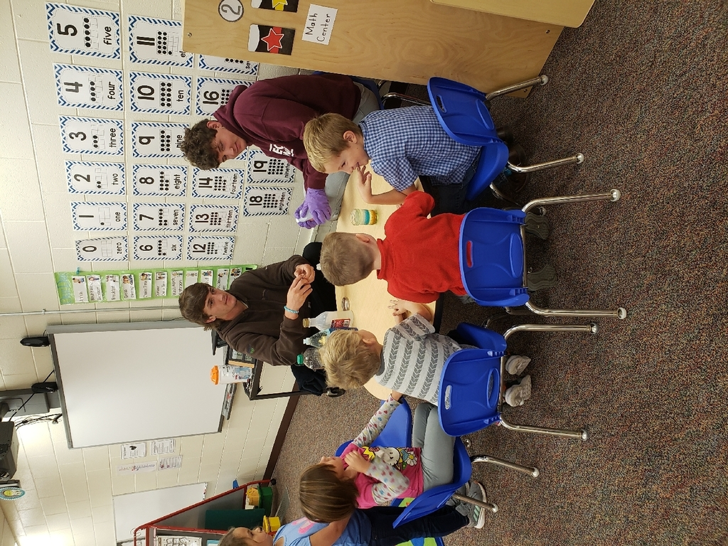 Connor and Kyle teaching pre-k students science.